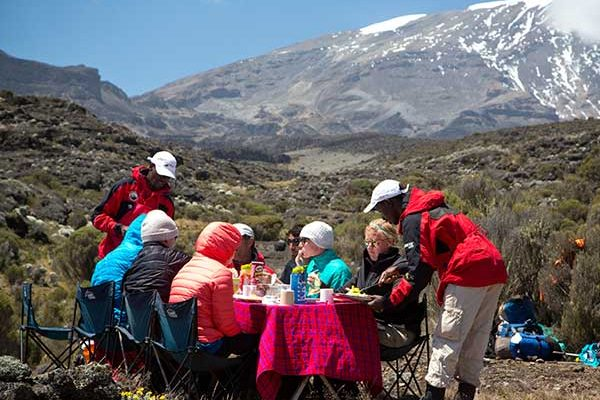 Kilimanjaro guides serving lunch on the mountain